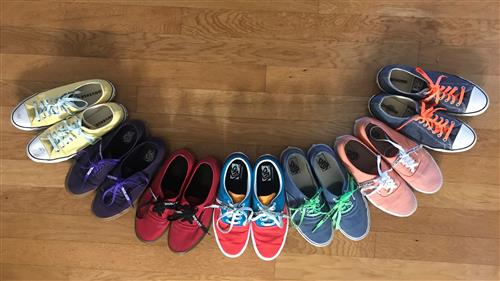 Smile made of a rainbow of shoes