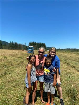 The kids and I in the hay field